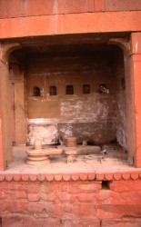A large, nameless tirtha containing a number of different linga. A symbol of the energy and power of Shiva, the linga is set in a conical base known as a yoni, a female symbol. The empty niches on the wall once contained icons long since disappeared