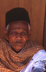 Torajan man in Rontepao. His circular black hat is typical of those who consider themselves of Bugi origin