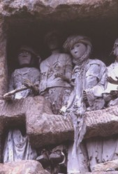 Cliff side effigies in village of Suaya
